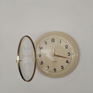 Orologio parete vintage H.A.U. in metallo color avorio